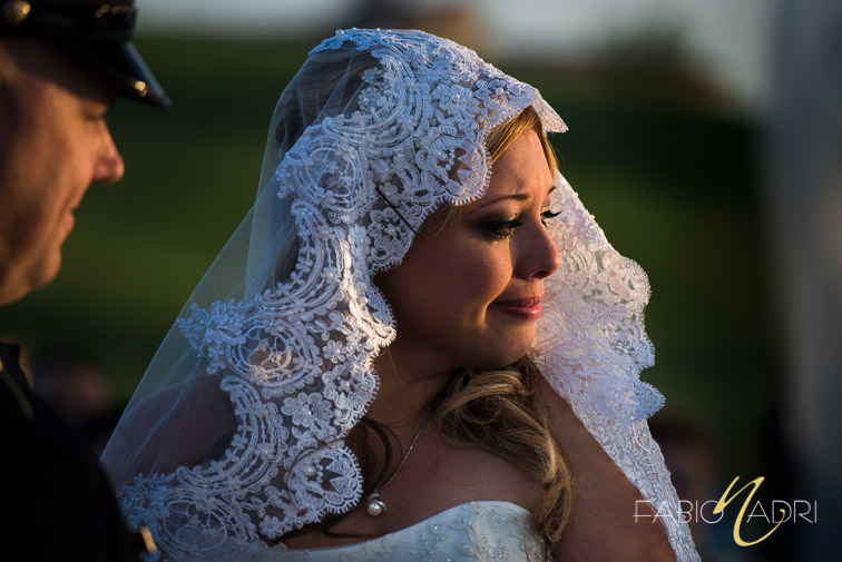 Tearful bride portrait sunset