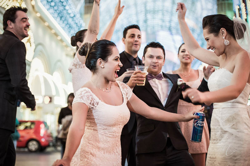 Couple bridal party dancing fremont street