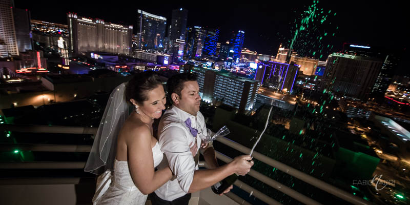 Bride groom popping champagne Vegas skyline