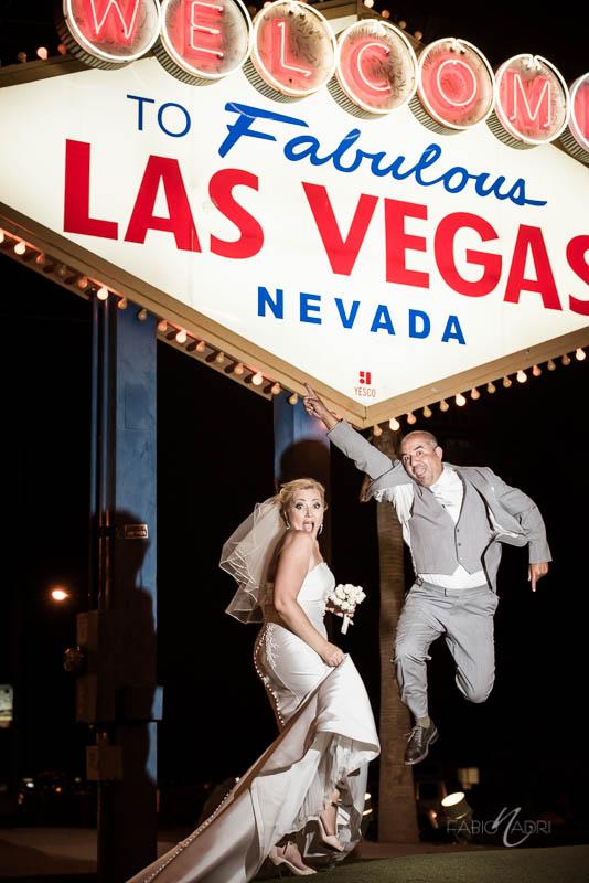 Bride groom jumping las vegas sign