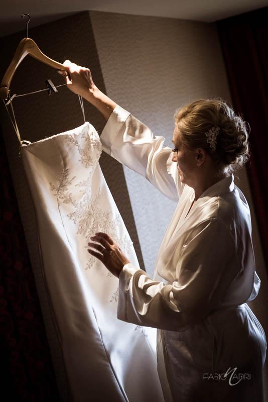 bride holding dress Bellagio executive suite