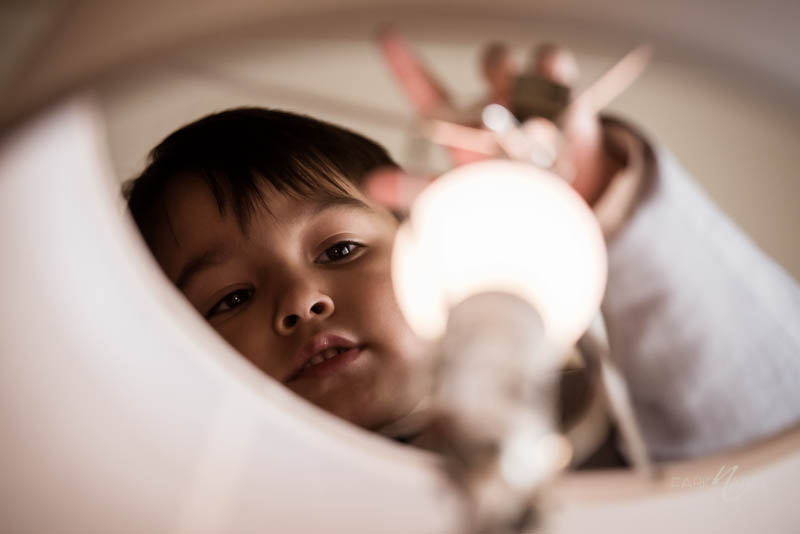 Kid playing with lamp