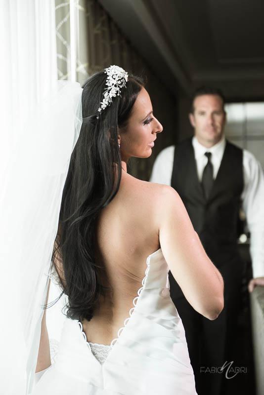 Bride putting on dress Four Season Las Vegas
