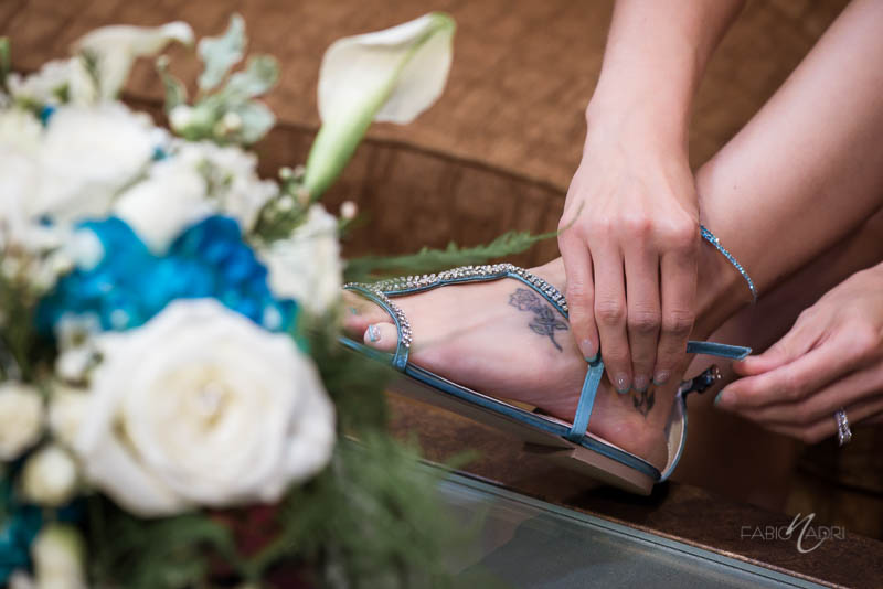 Bride putting on flats