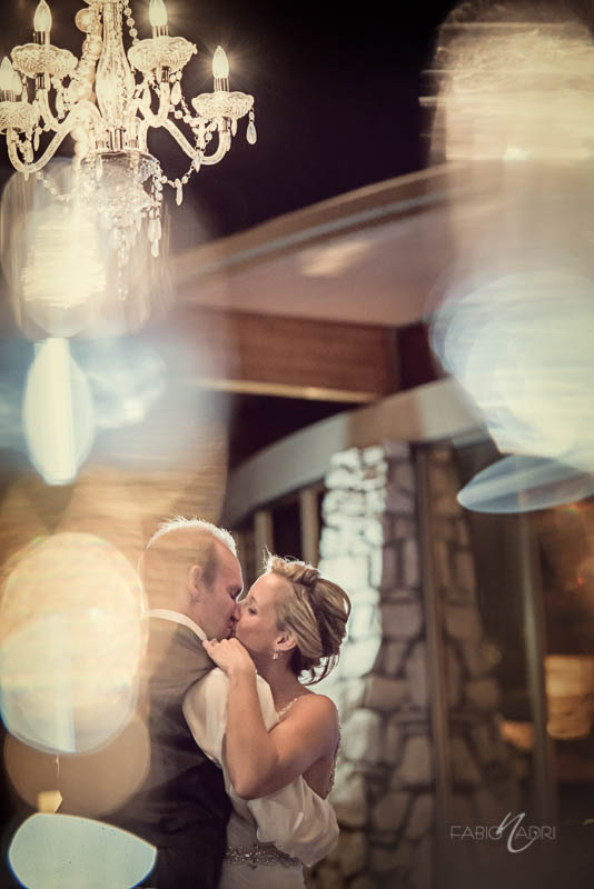 Bride groom kiss bistro string lights
