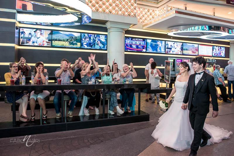 Bride groom cheers Fremont Street