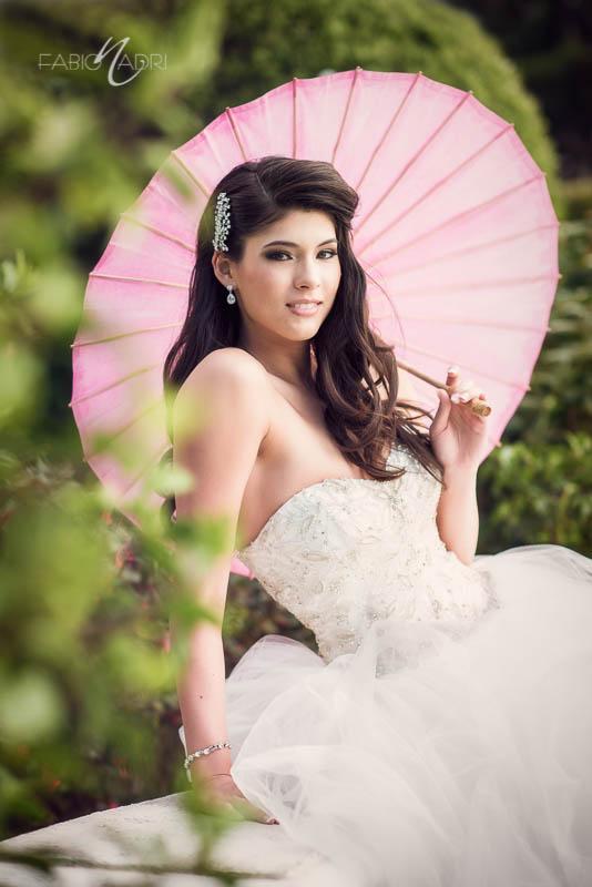 Bride pink parasol portrait