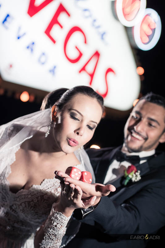 bride blowing dice las vegas sign