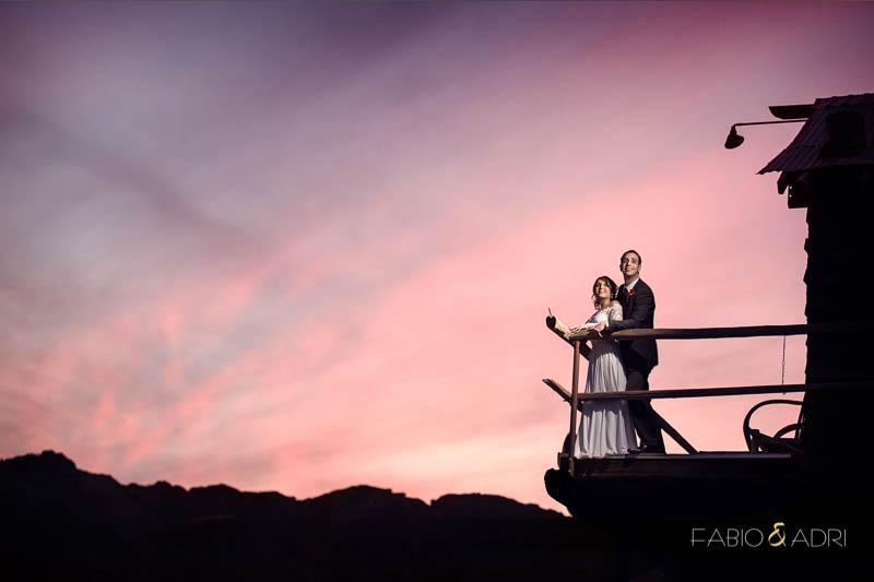 Bride groom pink sunset
