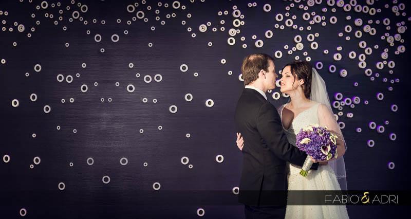 bride groom wedding photo Aria purple wall