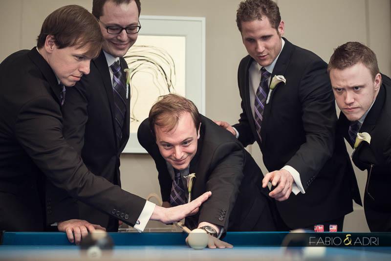 grom groomsman playing pool