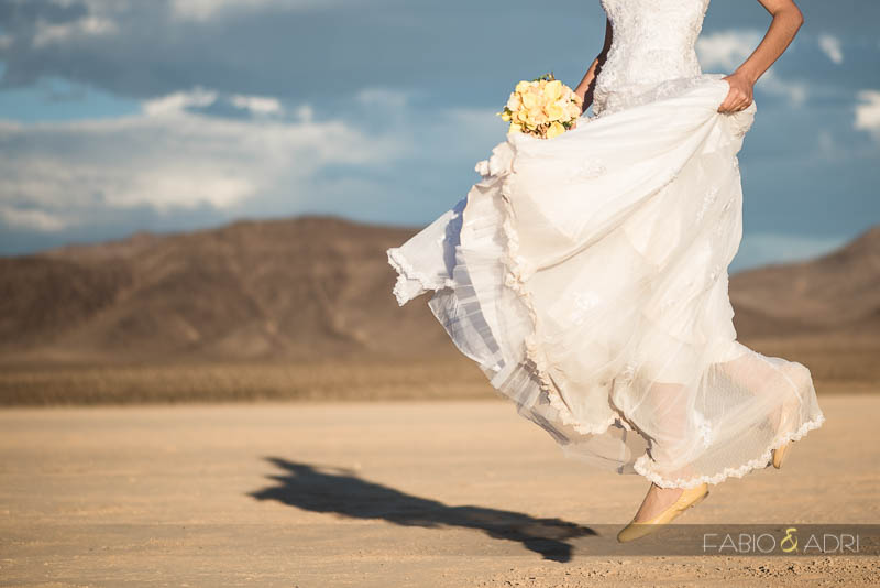 Desert Wedding Photo Couple Against Clouds