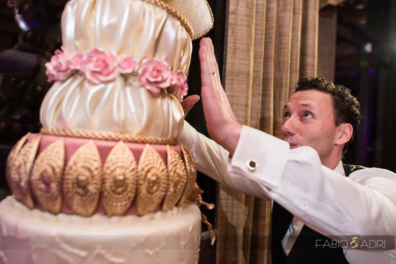 Groom Holding Falling Cake