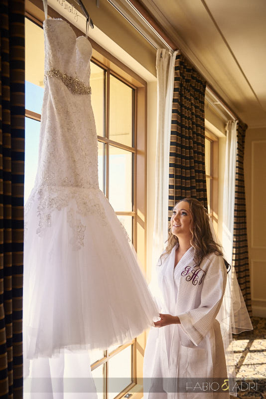 Bride Looking at Dress GVR