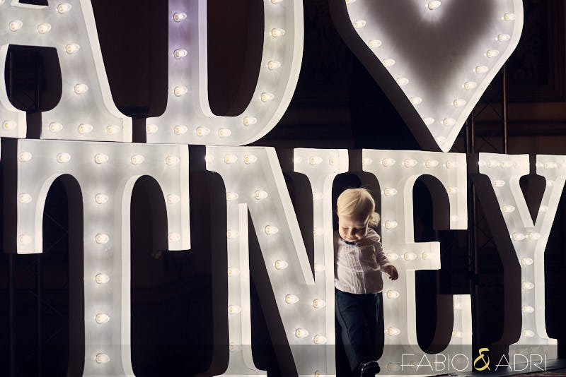 Kid Playing with Marquee Lights