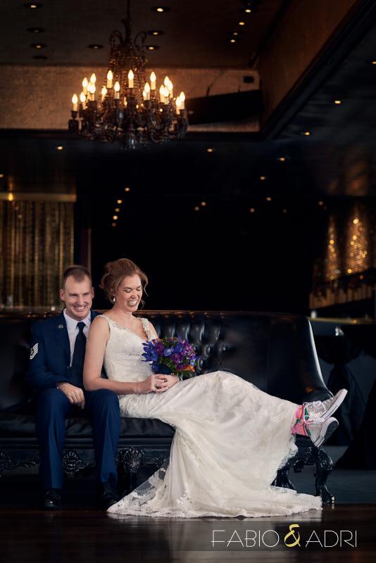 Fun Bride Wearing Converse and Dinosaur Socks with Air Force Groom