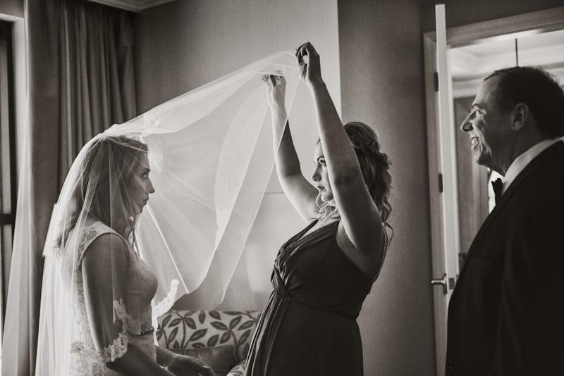 Bride Putting on Veil Las Vegas Wedding