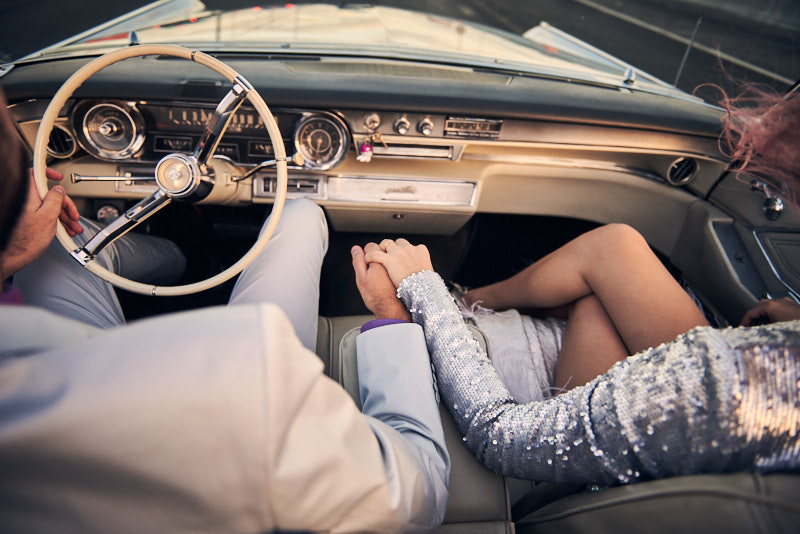 Bride Groom Holding Hands Driving Cadillac