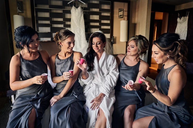 Bride and Bridesmaids Having a Shot Getting Ready Waldorf Astoria Las Vegas