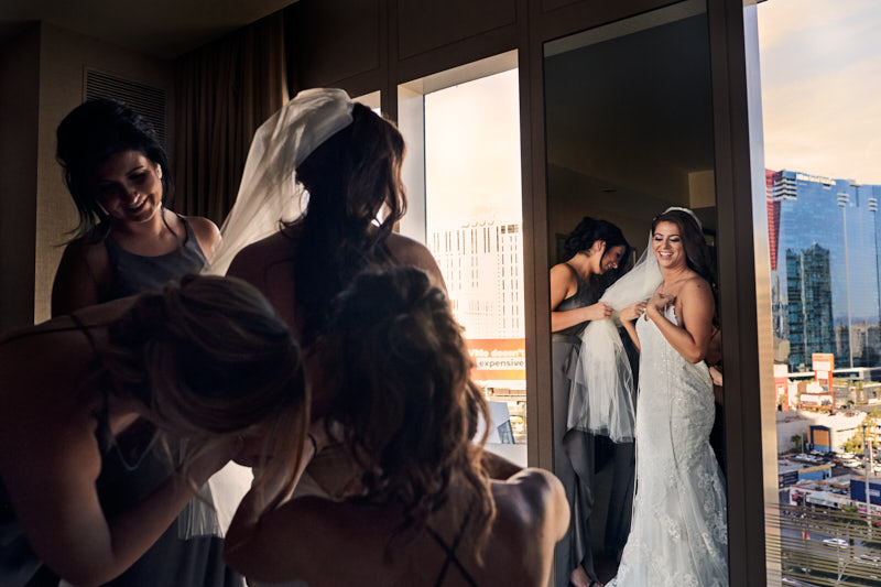 Bride Putting on Dress Waldorf Astoria Las Vegas