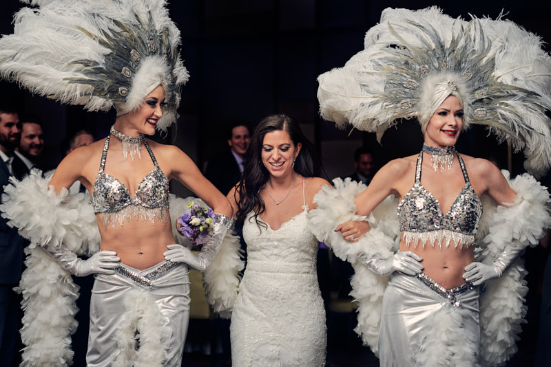 Bride Grand Entrance with Showgirls Waldorf Astoria Las Vegas